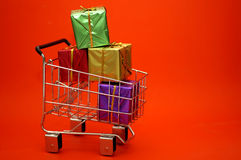 Gift Shopping. Wrapped presents in a shopping cart. Can be used for Christmas or other occasions stock photo