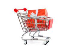 Gift in shopping cart Stock Photos