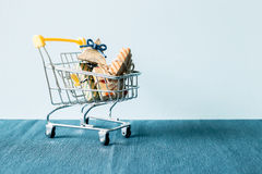Gift on shopping cart Royalty Free Stock Photo