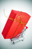 Gift in a shopping cart Stock Photography