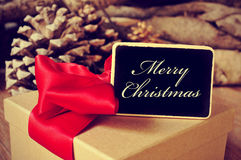 Gift and signboard with the text merry christmas Royalty Free Stock Image