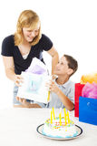 Gift From Sister. Little boy gets a birthday gift from his older sister. White background royalty free stock photos