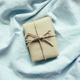 Gift on skyblue cloth background. Top view royalty free stock photography