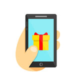 Gift in smartphone concept. Phone in hand. Vector flat illustration icon. Isolated on white. Background Royalty Free Stock Image