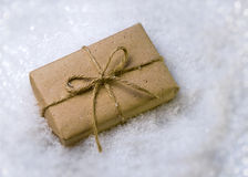 Gift in snow Royalty Free Stock Photos
