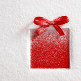 Gift on snow background. Gift with a bow on snow background Royalty Free Stock Photo