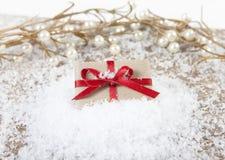 Gift on snow Royalty Free Stock Photos