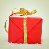 Gift on the snow Royalty Free Stock Photo