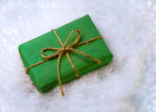 Gift in snow Stock Photos
