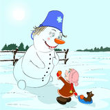 Gift for a snowman. The girl gives a snowman an orange Royalty Free Stock Photo
