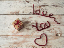 Gift for someone with I love you letters on wooden background. close up. Text space. Gift for St. Valentine`s Day.  Stock Photo