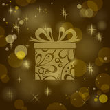 Gift on sparkling background Royalty Free Stock Photography