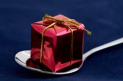 Gift on spoon Royalty Free Stock Photo