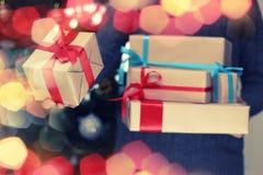 Gift stack hand christmas Royalty Free Stock Image