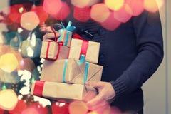 Gift stack hand christmas Stock Image