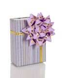 Gift in striped box decorated with bow Stock Photo