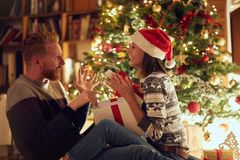 Gift surprise for Christmas- romantic holiday surprise royalty free stock photos