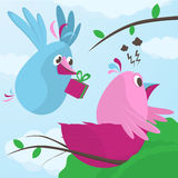 Gift from a sweetheart. As a sweet little blue bird flies in to his nest carrying a gift box in its beak to cheer up his pink female mate who is having a bad Stock Image