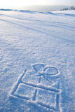 Gift symbol in snow Royalty Free Stock Photo