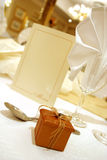 Gift on table. Little boxed gift on a wedding table Royalty Free Stock Photo