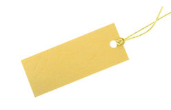 Gift tag. Crossgrained yellow paper gift tag with visible texture on white background Royalty Free Stock Image