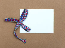 Gift tag with beautiful bow Stock Images