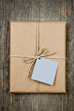 Gift with tag in brown paper Royalty Free Stock Image