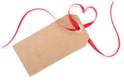 Gift tag with heart bow. Blank gift tag with a heart shaped red satin ribbon bow Stock Images