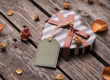 Gift tag and heart shaped gift box Royalty Free Stock Photos