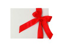 Gift tag with red ribbon isolated Stock Photos