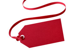 Gift tag, red, with ribbon isolated on white Stock Images