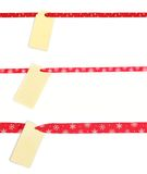 Gift tag tied with red satin ribbon royalty free stock photos