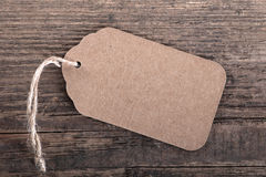 Gift tag. On wooden background Stock Photo