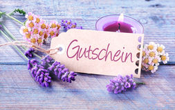 Gift tag with the word Gutschein in German Royalty Free Stock Image