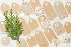 Gift tags for Christmas. Many tags for Christmas gifts, a ball of rope and a pine branch Stock Images