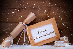 Gift With Text Frohe Weihnachten Mean Merry Christmas, Snowflake Stock Photos
