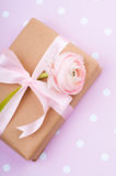 Gift tied with a ribbon with flower Stock Photo