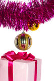 Gift with tinsel and toys Royalty Free Stock Image