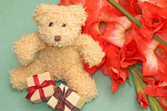 Gift to girlfriend - teddy bear and flowers Stock Photos