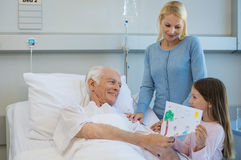 Gift to old grandfather patient royalty free stock photo