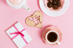 Gift to Valentine's Day, with tea and cupids on a pink background. Top view, film effect Royalty Free Stock Photography