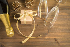 Gift toast champagne. On wooden floor Stock Images
