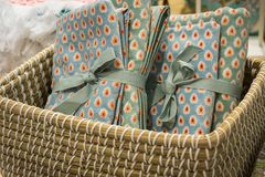 Gift towels with a dot pattern, tied with braid in a wicker basket. royalty free stock photo