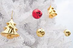 Gift and toys on white christmas tree Royalty Free Stock Photos