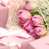 Gift and tulip flowers beautiful background Royalty Free Stock Photos