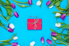 Gift and tulips Stock Photography