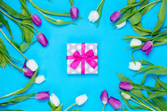 Gift and tulips Royalty Free Stock Photo