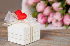Gift and tulips Stock Photos