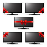 Gift tv with a red ribbon. On a white background Royalty Free Stock Images