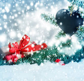 Gift under Christmas tree in snow Royalty Free Stock Images